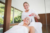 Peaceful brunette getting micro dermabrasion — Stock Photo