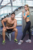 Bodybuilding man and woman posing — Stock Photo