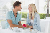 Hip couple having desert and coffee — Stock Photo