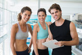 Fit women with trainer taking notes — Stock Photo