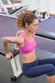 Fit woman exercising using the bench — Stock Photo