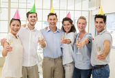 Business team celebrating with champagne — Stockfoto