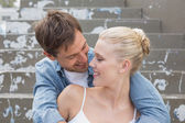 Couple sitting on steps showing affection — Stock Photo