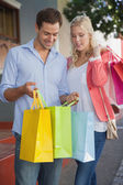 Stylish couple on a shopping trip — Stock Photo
