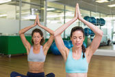 Women doing yoga in studio — Stock Photo