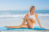 Blonde in seated yoga pose — Stock Photo