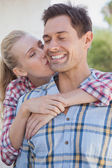 Hip couple wearing check shirts — Stock Photo