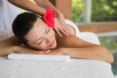 Brunette enjoying a peaceful massage — Stock Photo