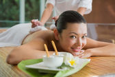 Brunette getting a herbal compress massage — Stock Photo
