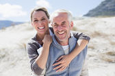 Hugging couple on the beach — Stock Photo