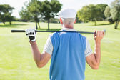 Golfer holding his club behind his head — Foto de Stock