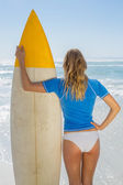 Blonde surfer holding her board — Stock Photo
