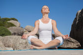 Woman sitting in lotus pose — Stock Photo