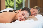 Friends getting hot stone massages — Stock Photo