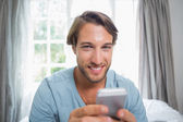 Man sending text message — Stock Photo