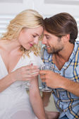 Couple having white wine — Stock Photo