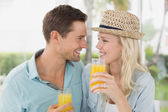 Hip couple drinking orange juice — Stock Photo