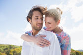 Smiling couple standing outside — Stock Photo