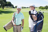 Golfer friends holding their golf bags — Foto de Stock