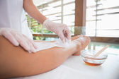 Woman getting her legs waxed — Stock Photo