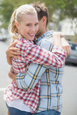 Couple in denim hugging each other — Foto Stock