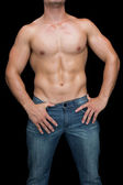 Muscular man posing in blue jeans — Stock Photo