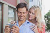Stylish couple looking at smartphone — Stock Photo