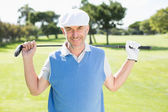Cheerful golfer smiling at camera — Stock fotografie