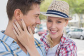 Young hip couple smiling — Stock Photo