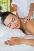 Brunette getting a shoulder massage — Stock Photo