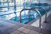 Swimming pool with hand rails — Stock Photo