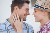 Young hip couple facing each other — Stock Photo