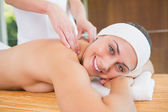 Woman getting a back massage — Stock Photo