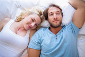 Couple relaxing on bed — Stock Photo