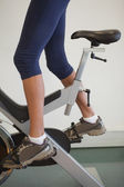 Fit woman on the spin bike — Stock Photo