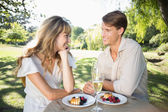 Couple having champagne and desert — Stock Photo