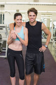 Fit attractive couple smiling — 图库照片