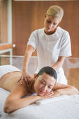 Brunette enjoying a peaceful massage — Stock Photo
