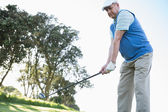 Golfer holding his golf club — Stock Photo