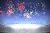 Fireworks exploding over football stadium — Stock Photo