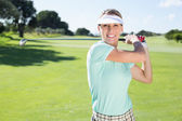 Lady golfer teeing off — Stock Photo