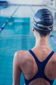 Swimmer standing by the pool — Stock Photo