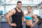 Bodybuilding man and woman frowning — Stock Photo