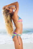Blonde in sunglasses on beach — Stock Photo