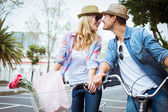Hip couple on a bike ride — Stock Photo