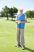 Cheerful golfer holding his club — Foto Stock