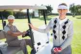 Golfing couple with their buggy — Foto de Stock