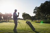 Golfer happy with his shot — Stock Photo