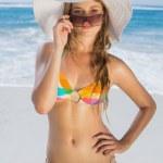 Girl in bikini and straw hat on beach — Stock Photo #48330277