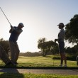 Golfing couple teeing off for the day — Stock Photo #48333115